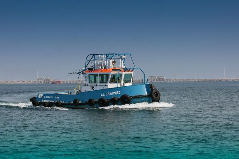 Tugboat in the midst of towage at the Ras Laffan Port