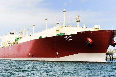 Nakilat's flagship Q-Max LNG carrier Mozah berthed at a terminal.
