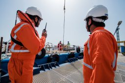 Nakilat agents overseeing the cargo loading process on a support vessel bound for anchorage